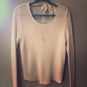 White, slouchy, open back sweater.